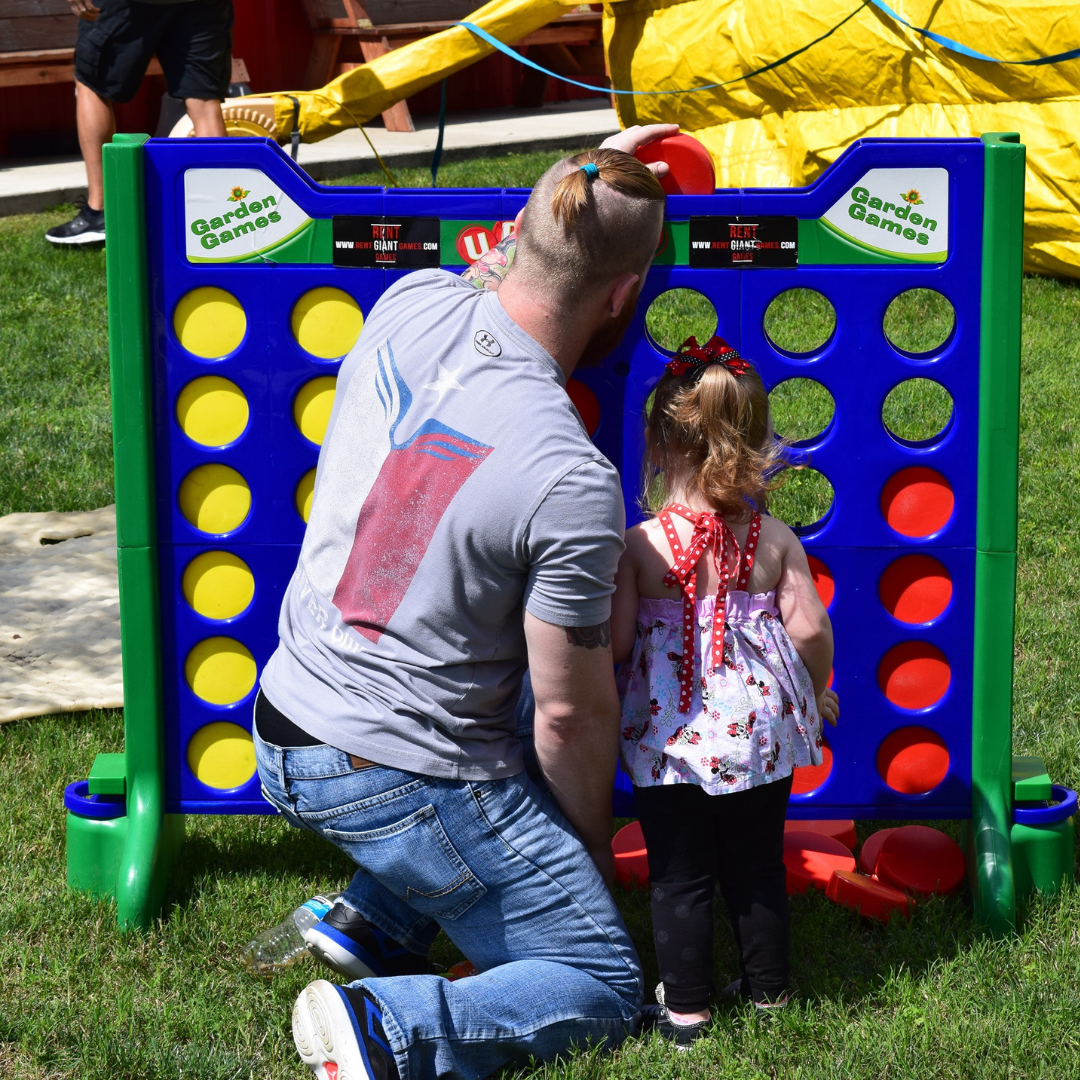 Man & Child playing Giant Connect Four