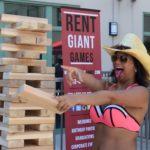 Woman Playing Giant Jenga